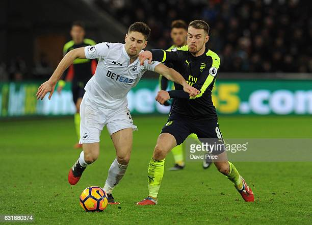 Aaron Ramsey of Arsenal closes down Federico Fernandez of Swansea during the Premier League match between Swansea City and Arsenal at Liberty Stadium...