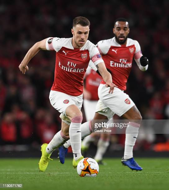 Aaron Ramsey of Arsenal controls the ball during the UEFA Europa League Round of 16 Second Leg match between Arsenal and Stade Rennais at Emirates...