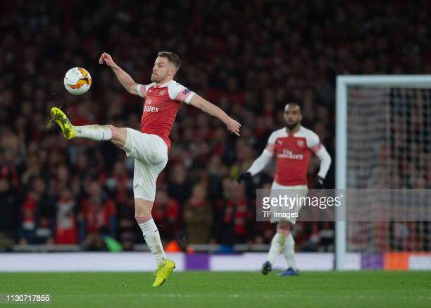 Aaron Ramsey of Arsenal controls the ball during the UEFA Europa League Round of 16 Second Leg match between Arsenal and Stade Rennes at Emirates...