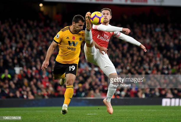 Aaron Ramsey of Arsenal controls the ball in mid air while being challenged by Jonny Otto of Wolverhampton Wanderers during the Premier League match...
