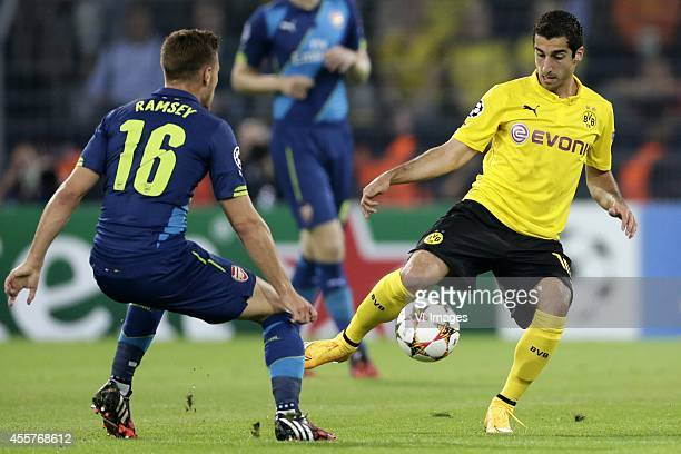 Aaron Ramsey of Arsenal FC Henrikh Mkhitaryan of Borussia Dortmund during the UEFA Champions League group D match between Borussia Dortmund and...
