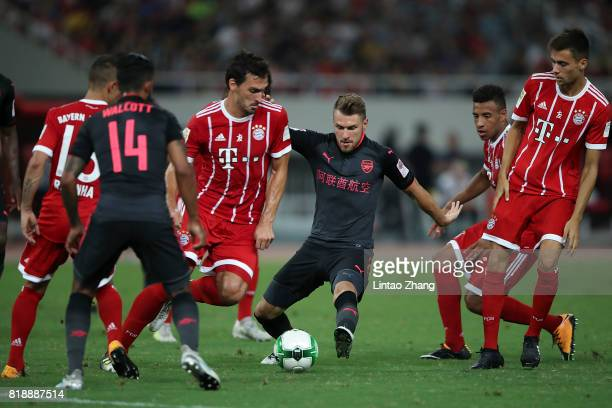 Aaron Ramsey of Arsenal FC of Arsenal FC competes for the ball with Mats Hummels of FC Bayern during the 2017 International Champions Cup football...