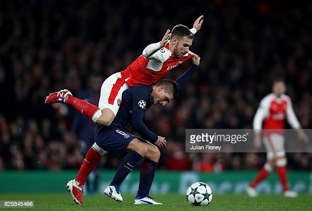 Aaron Ramsey of Arsenal fouls Marco Verratti of PSG during the UEFA Champions League Group A match between Arsenal FC and Paris SaintGermain at the...