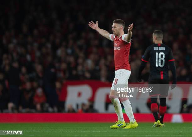 Aaron Ramsey of Arsenal gestures during the UEFA Europa League Round of 16 Second Leg match between Arsenal and Stade Rennes at Emirates Stadium on...