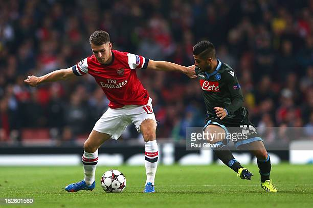 Aaron Ramsey of Arsenal holds off the challenge from Lorenzo Insigne of Napoli during UEFA Champions League Group F match between Arsenal FC and SSC...