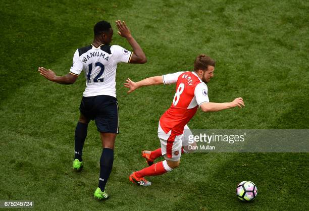 Aaron Ramsey of Arsenal holds off Victor Wanyama of Tottenham Hotspur during the Premier League match between Tottenham Hotspur and Arsenal at White...