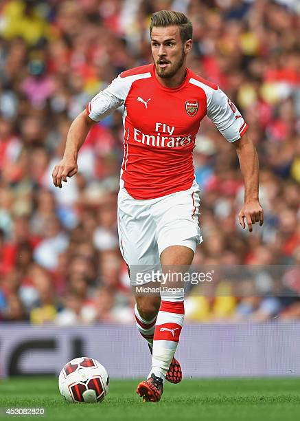 Aaron Ramsey of Arsenal in action during the Emirates Cup match between Arsenal and Benfica at the Emirates Stadium on August 2 2014 in London England