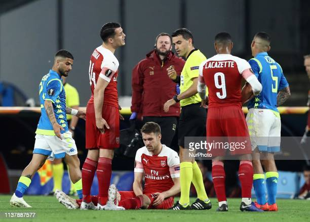 Aaron Ramsey of Arsenal injured during the UEFA Champions League quarterfinals second leg football match SSC Napoli v Arsenal Fc at the San Paolo...