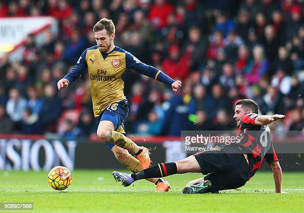 Aaron Ramsey of Arsenal is challenged by Andrew Surman of Bournemouth during the Barclays Premier League match between AFC Bournemouth and Arsenal at...