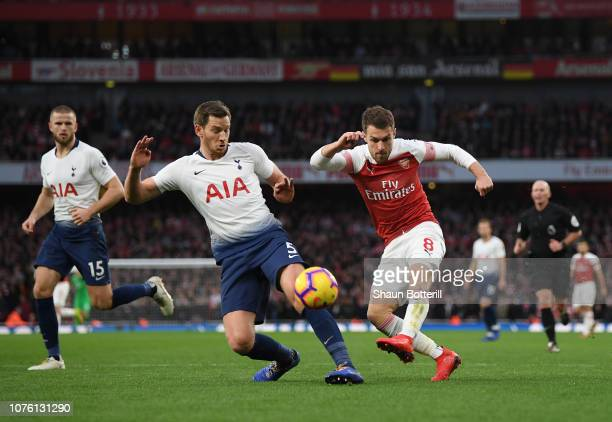 Aaron Ramsey of Arsenal is challenged by Jan Vertonghen of Tottenham Hotspur during the Premier League match between Arsenal FC and Tottenham Hotspur...