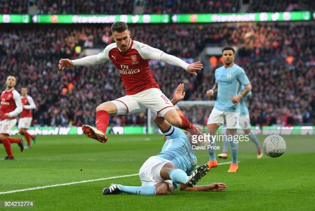 Aaron Ramsey of Arsenal is challenged by Vincent Kompany of Man City during the match between Arsenal and Manchester City at Wembley Stadium on...