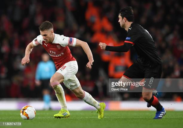 Aaron Ramsey of Arsenal is closed down by Clement Grenier of Rennais during the UEFA Europa League Round of 16 Second Leg match between Arsenal and...