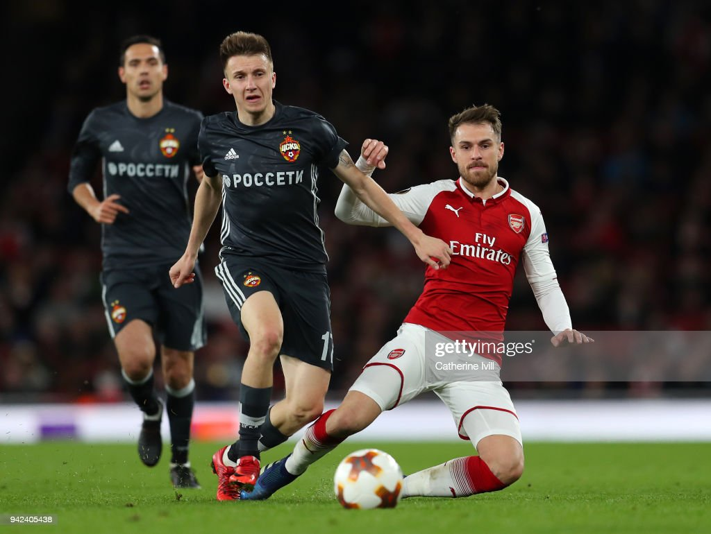 Aaron Ramsey of Arsenal is tackled by Aleksandr Golovin of CSKA Moskva during the UEFA Europa League quarter final leg one match between Arsenal FC and CSKA Moskva at Emirates Stadium on April 5, 2018 in London, United Kingdom.