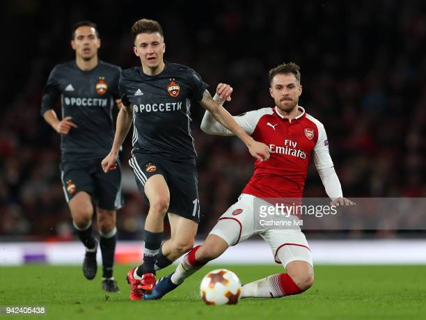 Aaron Ramsey of Arsenal is tackled by Aleksandr Golovin of CSKA Moskva during the UEFA Europa League quarter final leg one match between Arsenal FC...