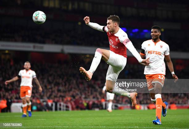 Aaron Ramsey of Arsenal jumps for the ball during the Carabao Cup Fourth Round match between Arsenal and Blackpool at Emirates Stadium on October 31...