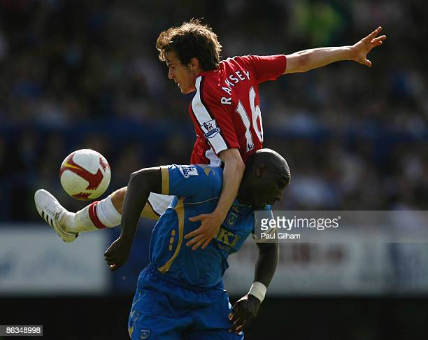 Aaron Ramsey of Arsenal jumps over Sol Campbell of Portsmouth during the Barclays Premier League match between Portsmouth and Arsenal at Fratton Park...