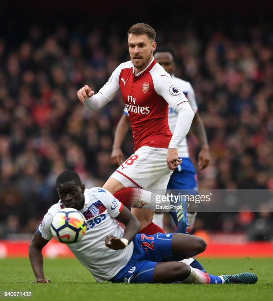 Aaron Ramsey of Arsenal knocks the ball past Badou Ndiaye of Stoke during the Premier League match between Arsenal and Stoke City at Emirates Stadium...