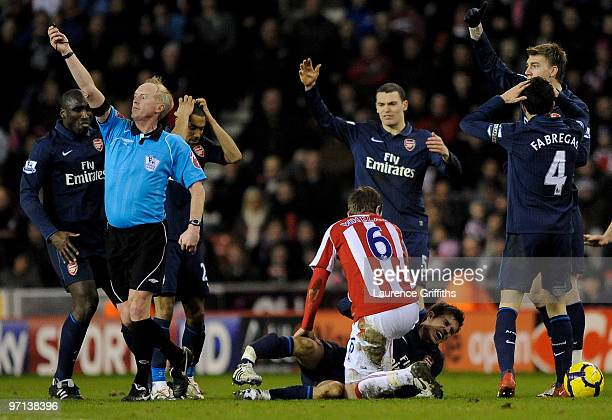 Aaron Ramsey of Arsenal lies seriously injured following a challenge by Ryan Shawcross of Stoke City during the Barclays Premier League match between...