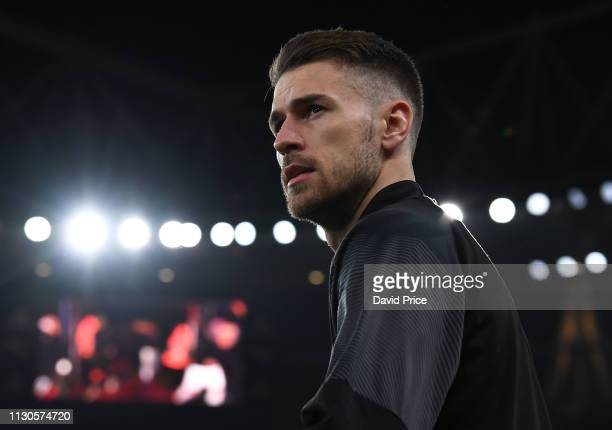 Aaron Ramsey of Arsenal looks on before the UEFA Europa League Round of 16 Second Leg match between Arsenal and Stade Rennais at Emirates Stadium on...