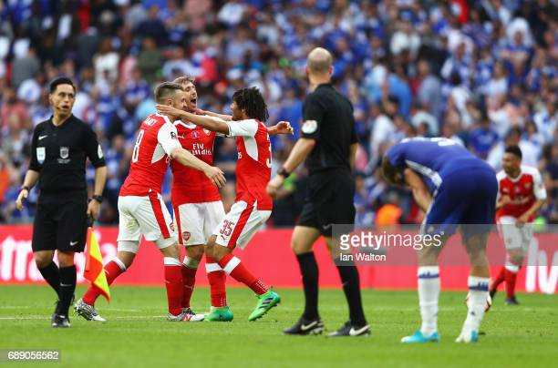 Aaron Ramsey of Arsenal Mohamed Elneny of Arsenal and Nacho Monreal of Arsenal celebrate after The Emirates FA Cup Final between Arsenal and Chelsea...