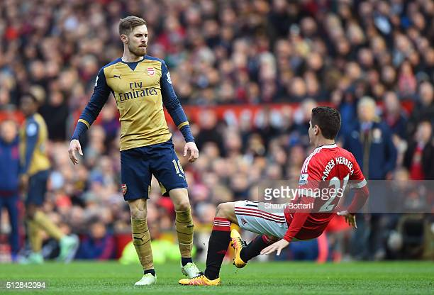 Aaron Ramsey of Arsenal pushes Ander Herrera of Manchester United during the Barclays Premier League match between Manchester United and Arsenal at...