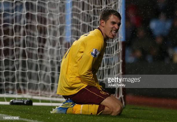 Aaron Ramsey of Arsenal reacts after missing a goal scoring chance during the Barclays Premier League match between Aston Villa and Arsenal at Villa...
