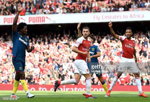 Aaron Ramsey of Arsenal reacts following scoring a goal that is disallowed for offiside during the Premier League match between Arsenal FC and West...