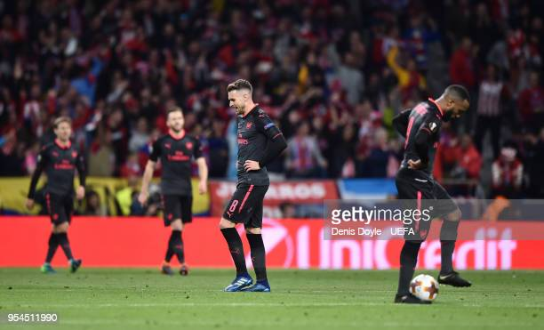 Aaron Ramsey of Arsenal reacts with teammates after Atletico Madrid scored their opening goal during the UEFA Europa League Semi Final second leg...