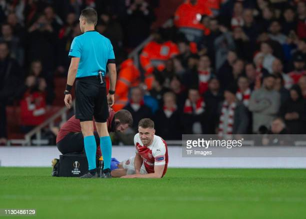 Aaron Ramsey of Arsenal receives medical treatment during the UEFA Europa League Round of 16 Second Leg match between Arsenal and Stade Rennes at...
