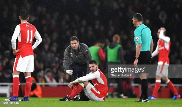 Aaron Ramsey of Arsenal receives medical treatment prior to be substituted during the Premier League match between Arsenal and Watford at Emirates...