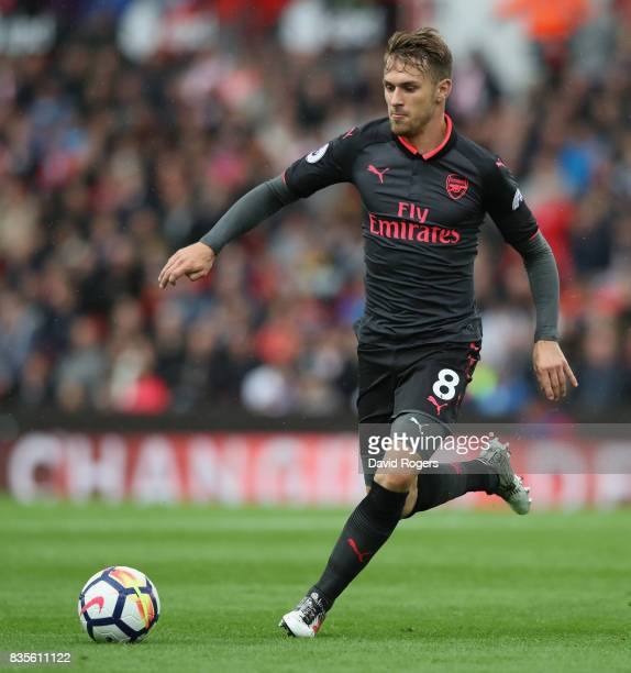 Aaron Ramsey of Arsenal runs with the ball during the Premier League match between Stoke City and Arsenal at Bet365 Stadium on August 19 2017 in...