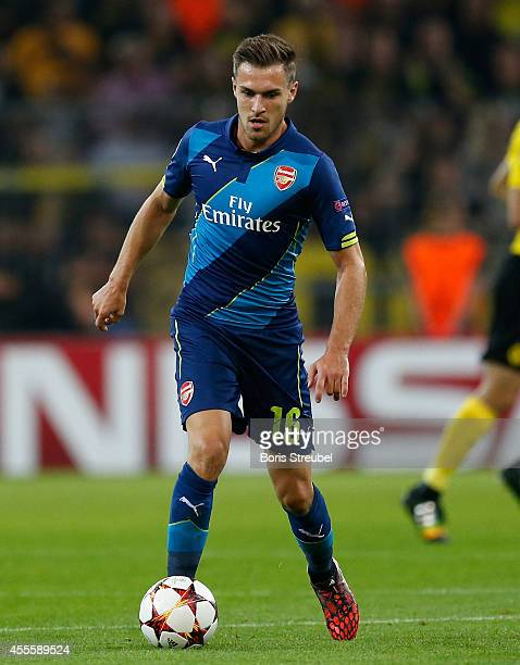 Aaron Ramsey of Arsenal runs with the ball during the UEFA Champions League Group D match between Borussia Dortmund and Arsenal at Signal Iduna Park...