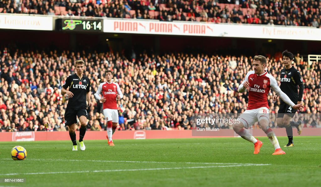 Aaron Ramsey of Arsenal scores his sides second goal during the Premier League match between Arsenal and Swansea City at Emirates Stadium on October 28, 2017 in London, England.