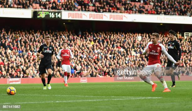 Aaron Ramsey of Arsenal scores his sides second goal during the Premier League match between Arsenal and Swansea City at Emirates Stadium on October...