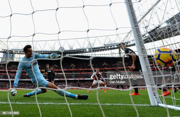 Aaron Ramsey of Arsenal scores his sides second goal past Lukasz Fabianski of Swansea City during the Premier League match between Arsenal and...