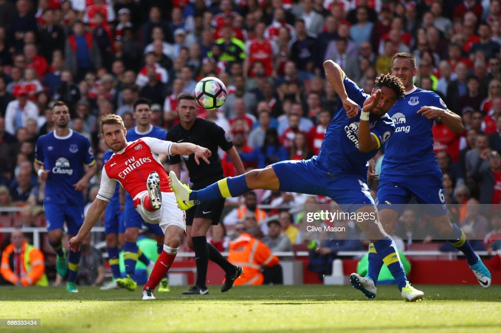 Aaron Ramsey of Arsenal scores his sides third goal during the Premier League match between Arsenal and Everton at Emirates Stadium on May 21, 2017 in London, England.