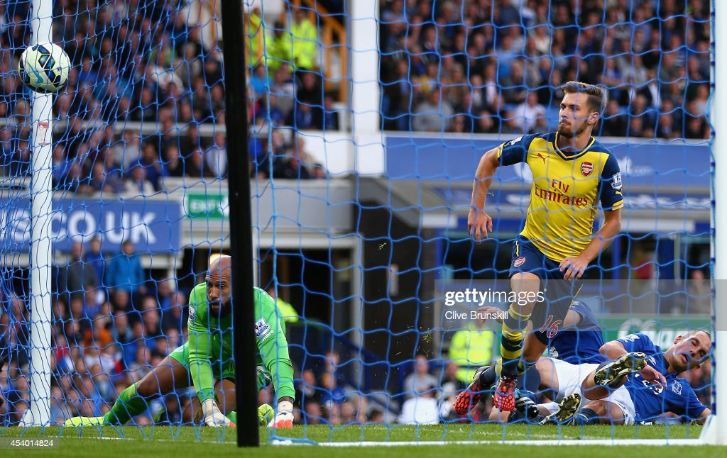 Aaron Ramsey of Arsenal scores his team's first goal during the Barclays Premier League match between Everton and Arsenal at Goodison Park on August 23, 2014 in Liverpool, England.