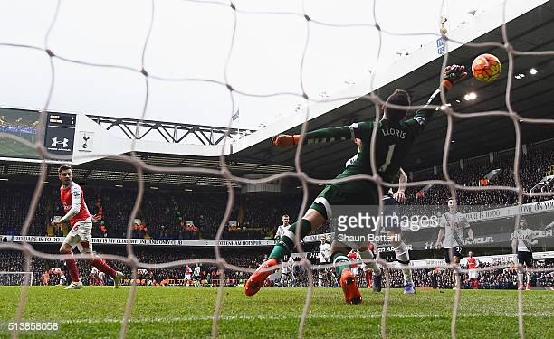 Aaron Ramsey of Arsenal scores his team's first goal past Hugo Lloris of Tottenham Hotspur during the Barclays Premier League match between Tottenham...
