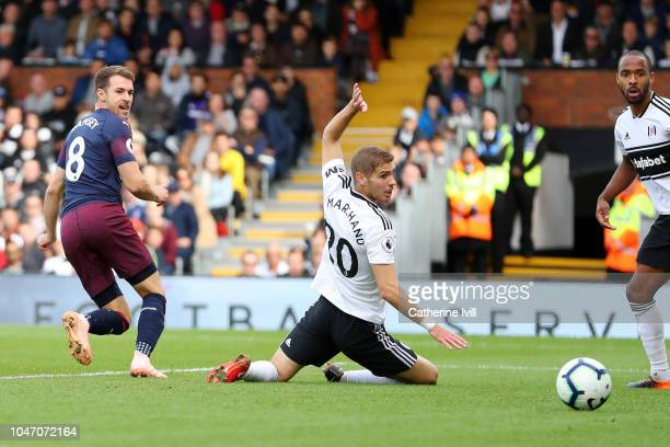 Aaron Ramsey of Arsenal scores his team's third goal during the Premier League match between Fulham FC and Arsenal FC at Craven Cottage on October 7...