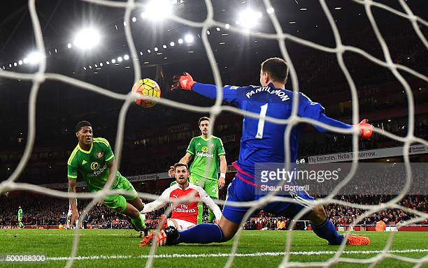Aaron Ramsey of Arsenal scores his team's third goal past Costel Pantilimon of Sunderland during the Barclays Premier League match between Arsenal...