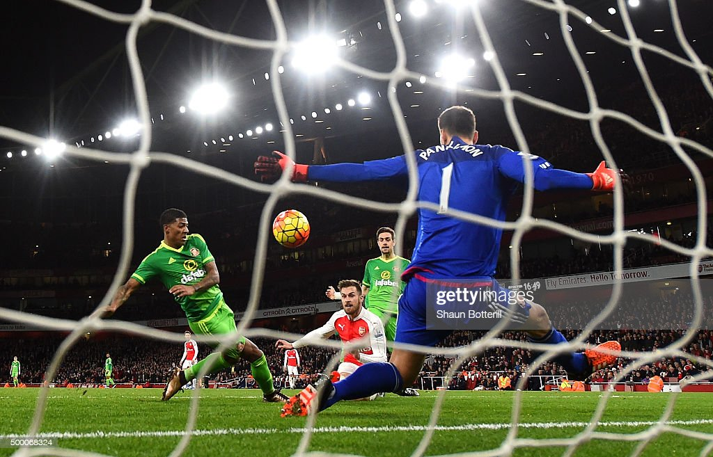 Aaron Ramsey of Arsenal scores his team's third goal past Costel Pantilimon of Sunderland during the Barclays Premier League match between Arsenal and Sunderland at Emirates Stadiumon December 5, 2015 in London, England.
