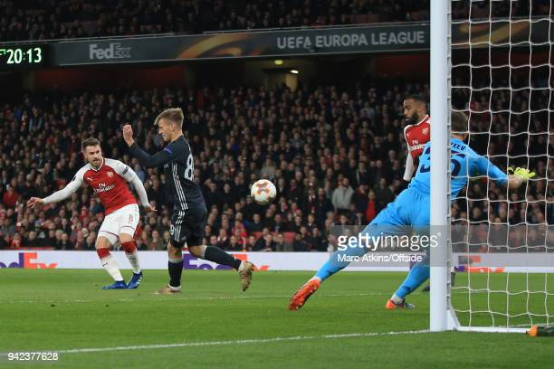 Aaron Ramsey of Arsenal scores the opening goal during the UEFA Europa League quarter final leg one match between Arsenal FC and CSKA Moskva at...