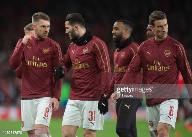 Aaron Ramsey of Arsenal Sead Kolasinac of Arsenal and Laurent Koscielny of Arsenal looks on prior to the UEFA Europa League Round of 16 Second Leg...