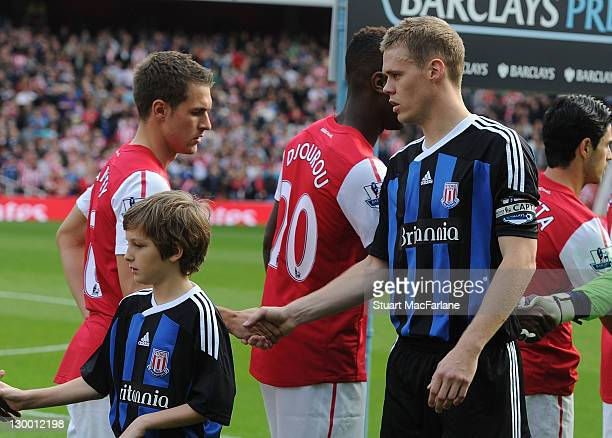 Aaron Ramsey of Arsenal shakes hands with Stoke defender Ryan Shawcross before the Barclays Premier League match between Arsenal and Stoke City at...