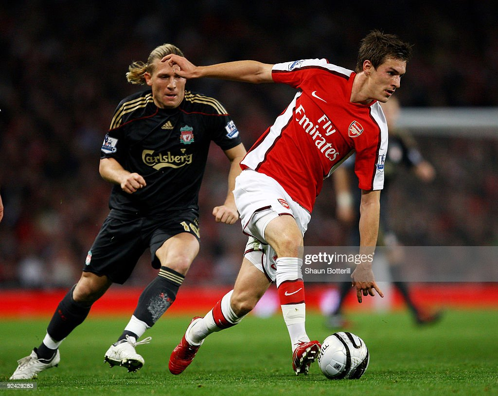 Aaron Ramsey of Arsenal shields the ball from Andriy Voronin of Liverpool during the Carling Cup 4th Round match between Arsenal and Liverpool at the Emirates Stadium on October 28, 2009 in London, England.