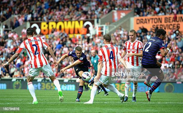 Aaron Ramsey of Arsenal shoots at goal during the Barclays Premier League match between Stoke City and Arsenal at The Britannia Stadium on August 26...