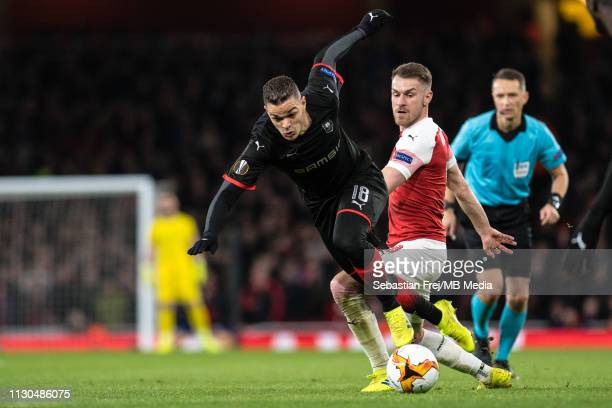 Aaron Ramsey of Arsenal tackle Hatem Ben Arfa of Stade Rennais during the UEFA Europa League Round of 16 Second Leg match between Arsenal and Stade...