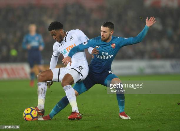 Aaron Ramsey of Arsenal tackles Leroy Fer of Swansea during the Premier League match between Swansea City and Arsenal at Liberty Stadium on January...