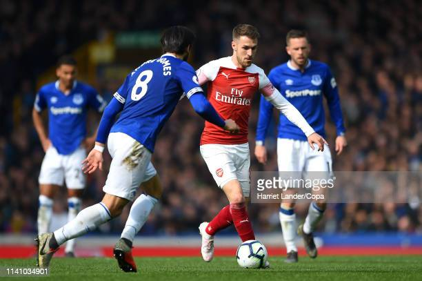Aaron Ramsey of Arsenal takes on Andre Gomes of Everton during the Premier League match between Everton FC and Arsenal FC at Goodison Park on April...