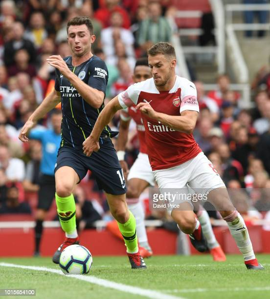 Aaron Ramsey of Arsenal takes on Aymeric Laporte of Man City during the match the Premier League match between Arsenal FC and Manchester City at...
